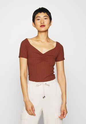 T-shirts - rust