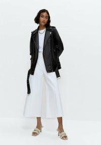 Uterqüe - Leather jacket - black - 1