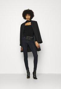 Guess - Jeans Skinny Fit - raw denim - 1