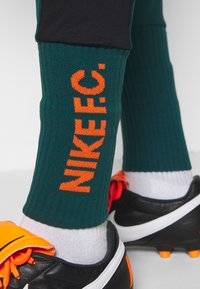 Nike Performance - PANT SOCK CUFF - Pantalon de survêtement - dark atomic teal/black/electro orange - 3