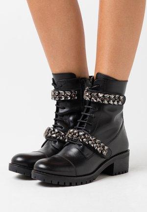 KRISTAL - Lace-up ankle boots - noir