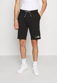 Calvin Klein - SUMMER GRAPHIC PRINT  - Shorts - black - 0
