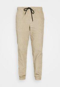 JUMBO JOGGER  - Trousers - beige