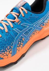 ASICS - FUJITRABUCO LYTE - Trail running shoes - directoire blue/shocking orange - 5