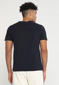 Champion - CREWNECK  - Print T-shirt - dark blue - 2