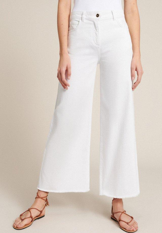 Široké džíny - bianco