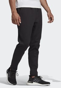adidas Performance - Z.N.E. SPORTSWEAR PRIMEGREEN PANTS - Tracksuit bottoms - black - 2