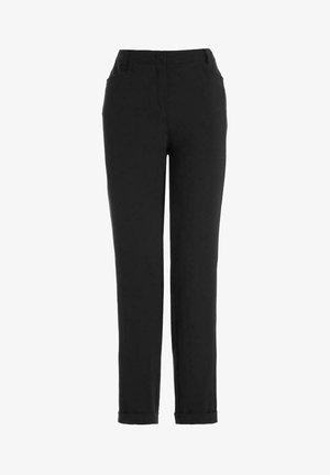 IM ZEITLOSEN SCHNITT - Trousers - black