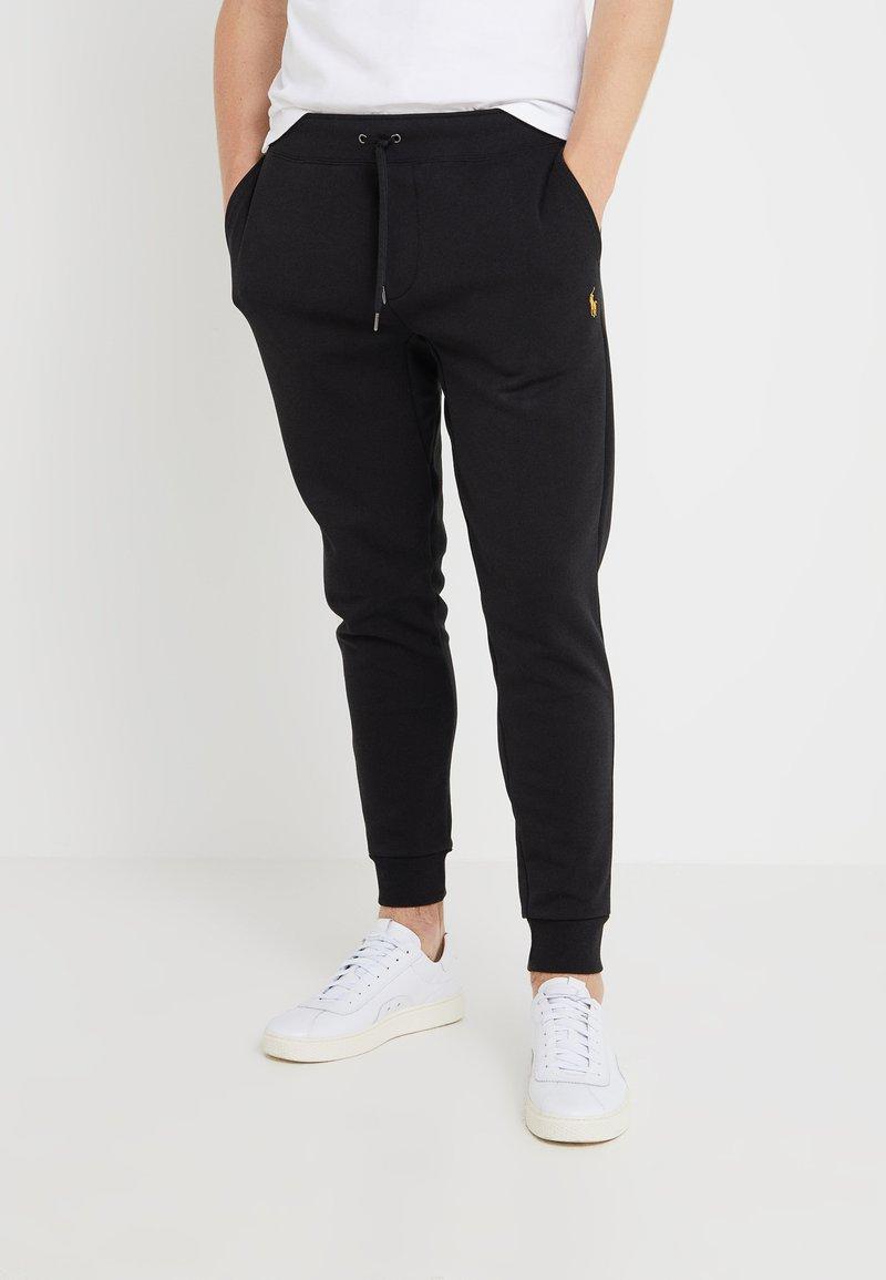 Polo Ralph Lauren - Pantalon de survêtement - black/gold