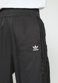 adidas Originals - BELLISTA NYLON CUFFED SPORT PANTS - Verryttelyhousut - black - 5