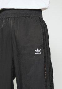 adidas Originals - BELLISTA NYLON CUFFED SPORT PANTS - Pantalones deportivos - black - 5
