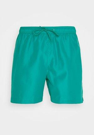 CORE PLACED LOGO MEDIUM DRAWSTRING - Plavky - green