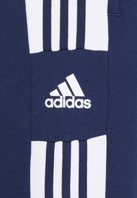 adidas Performance - SQUAD - Tracksuit bottoms - team navy blue - 2