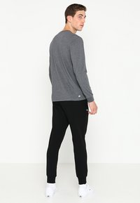 Lacoste Sport - CLASSIC PANT - Träningsbyxor - black - 2