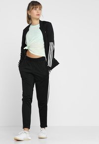 adidas Performance - ESSENTIALS 3STRIPES SPORT TRACKSUIT - Tracksuit - black/white - 1