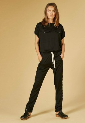 SHINY SLIM FIT - Trousers - black