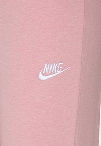 Nike Sportswear - TIGHT - Tracksuit bottoms - pink glaze/white - 5
