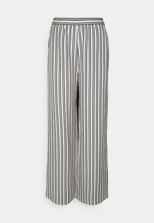 VALERY PANTS - Trousers - beige/black