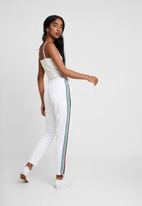 Urban Classics - DAMEN LADIES SIDE TAPED TRACK PANTS - Tracksuit bottoms - white - 2