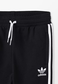 adidas Originals - TREFOIL PANTS - Verryttelyhousut - black/white - 2