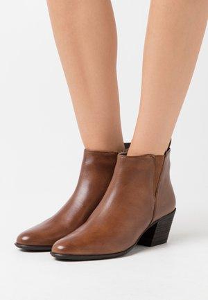 ADDISON - Ankle boots - cognac
