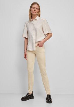 MAVAS - Slim fit jeans - blushed camel