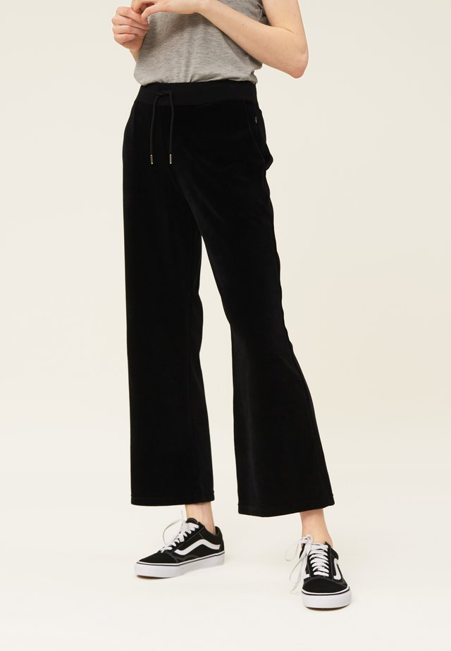 LEONA  - Tracksuit bottoms - black