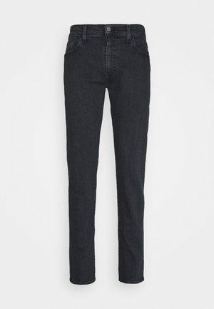 512™ SLIM TAPER - Zúžené džíny - blacks