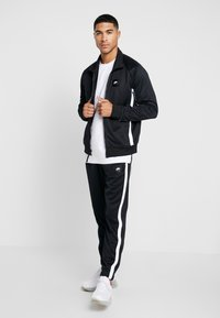 Nike Sportswear - AIR PANT - Träningsbyxor - black/white - 1