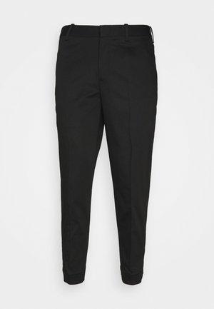 TRAVEL REGULAR RISE TROUSERS - Trousers - black