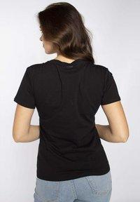 LIU JO - Print T-shirt - black - 1
