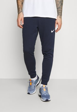 PANT TAPER - Trainingsbroek - obsidian/white