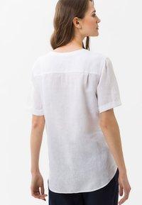 BRAX - STYLE VANIA - Button-down blouse - white - 2