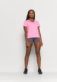 Nike Performance - MILER V NECK - T-Shirt print - pink glow/silver - 1