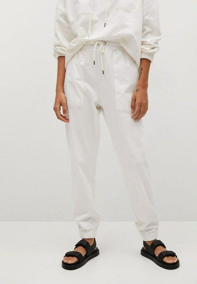 Pantalon de survêtement - kremowy / écru