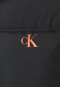 Calvin Klein Jeans - COLOURBLOCK PUFFER - Winter jacket - black/ white / red - 6