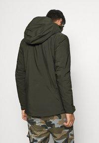 Peak Performance - MAROON LONG JACKET - Ski jacket - coniferous green - 2