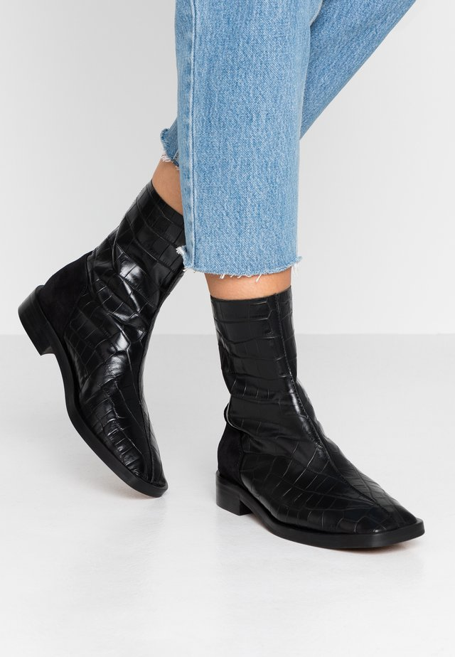 GOSS - Classic ankle boots - black