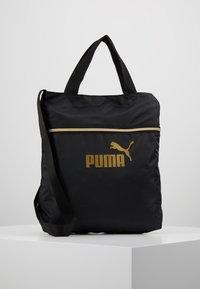 Puma - CORE SEASONAL SHOPPER - Tote bag - black/gold - 0