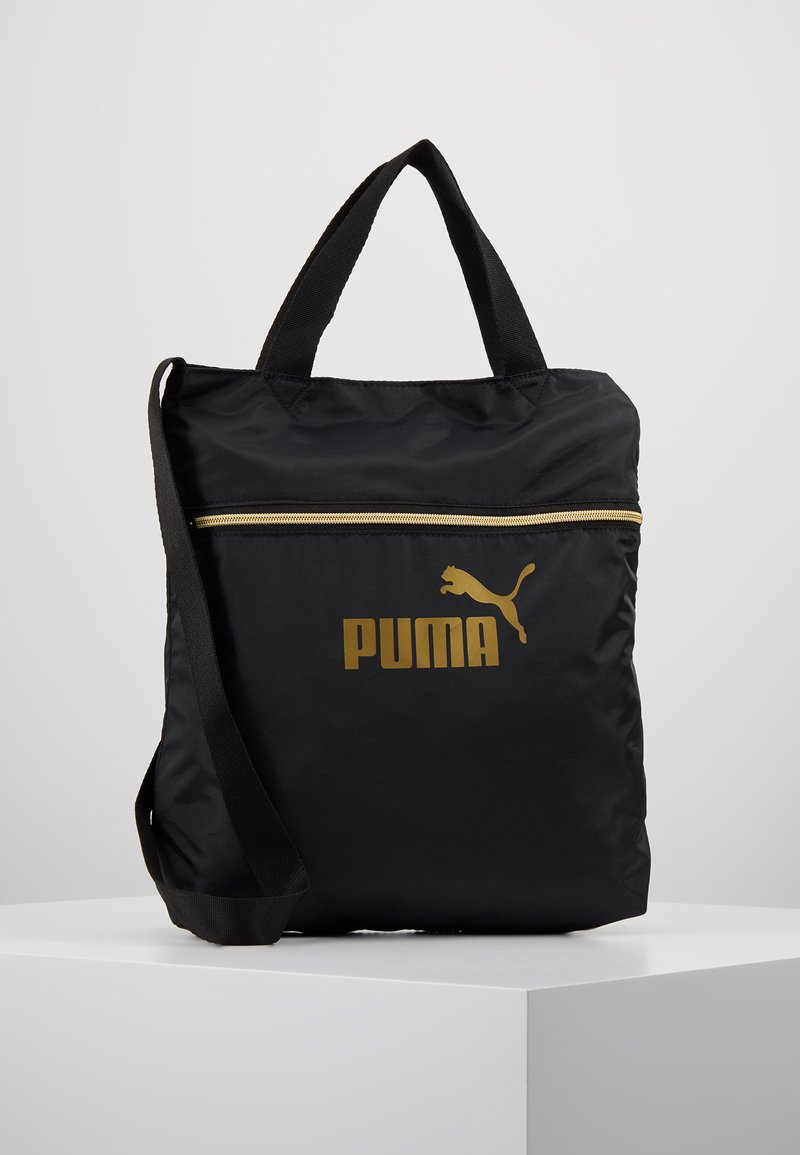 Puma - CORE SEASONAL SHOPPER - Tote bag - black/gold