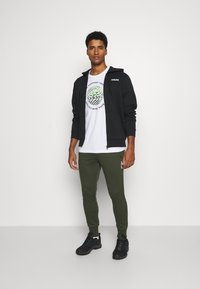 Jack & Jones - JJWILL PANTS - Tracksuit bottoms - forest night - 1