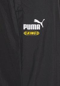 Puma - ICONIC KING TRACK PANTS - Tracksuit bottoms - puma black - 3