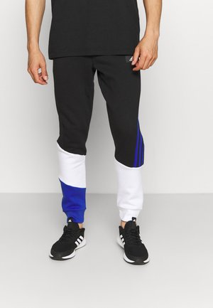 COLORBLOCK SEASONAL - Tracksuit bottoms - black/bold blue