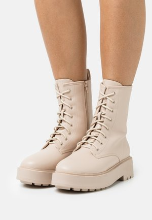 PERFECT LACED UP BOOT - Platform ankle boots - creme