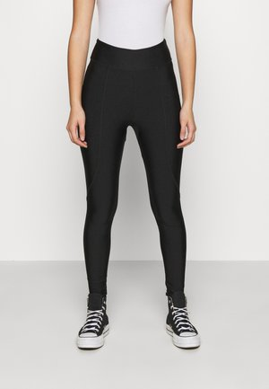 OVERLOCKED PANELLED SHINE - Leggings - Trousers - black