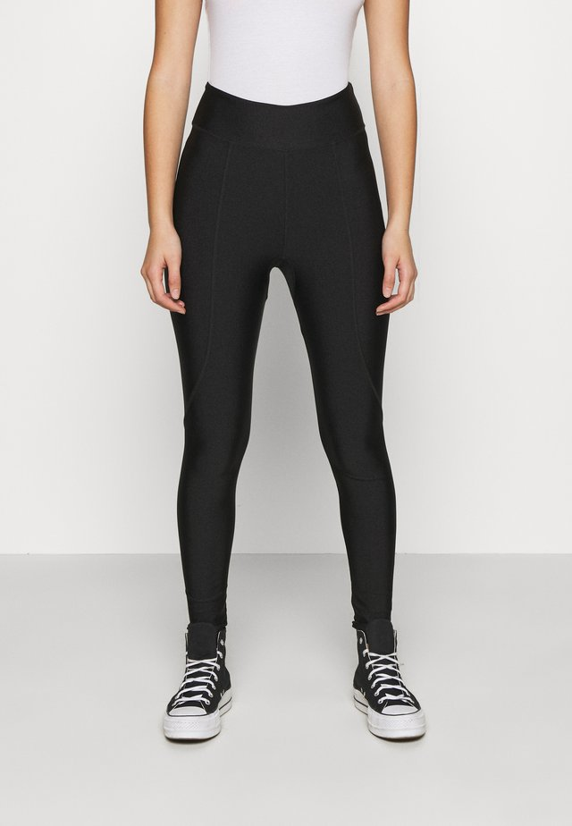 OVERLOCKED PANELLED SHINE - Leggingsit - black