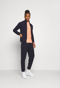 Daily Basis Studios - TRACK PANT - Tracksuit bottoms - navy - 1