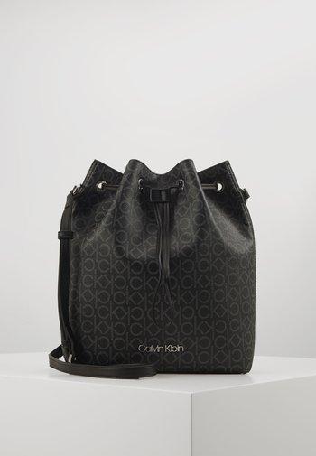 DRAWSTRING BUCKET BAG MONOGRAM - Across body bag - black