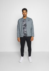 Nike Performance - DRY TEAM - Training jacket - smoke grey - 1