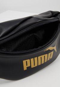 Puma - CORE UP WAISTBAG - Riñonera - black/gold - 4